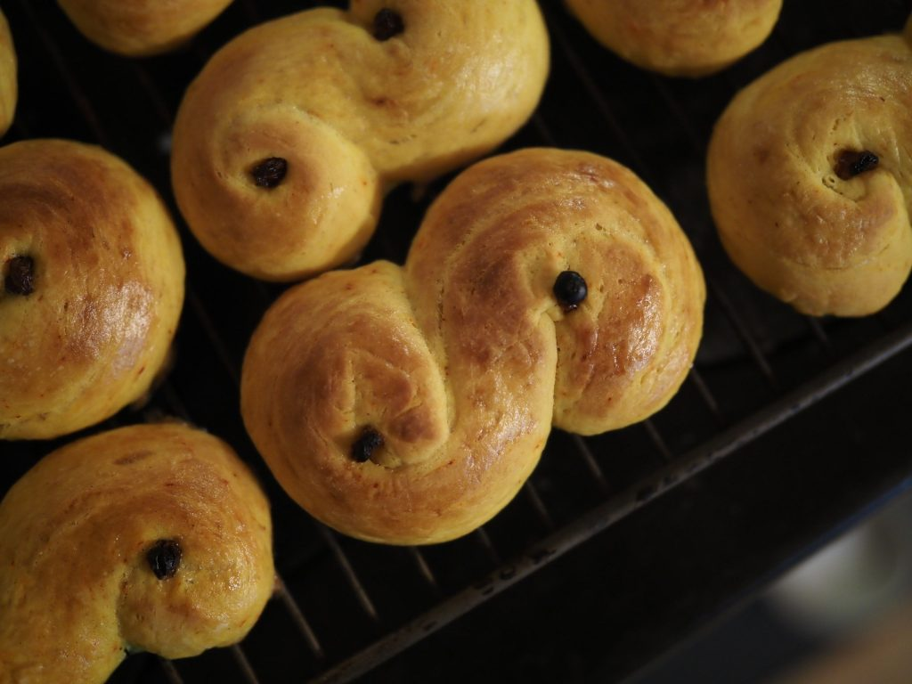 A perfectly baked, golden brown saffron bun, fresh out of the oven.